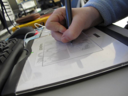 Student working with drawing tablet.